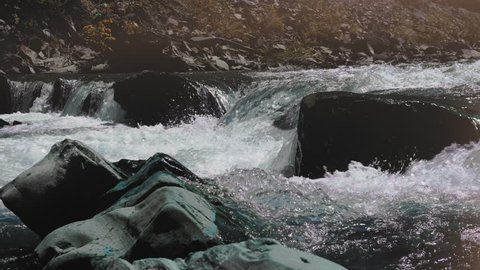 Raging Mountain river. Wildness of clean, clear water in the mountain river. Slow Motion. concept of orgasm.