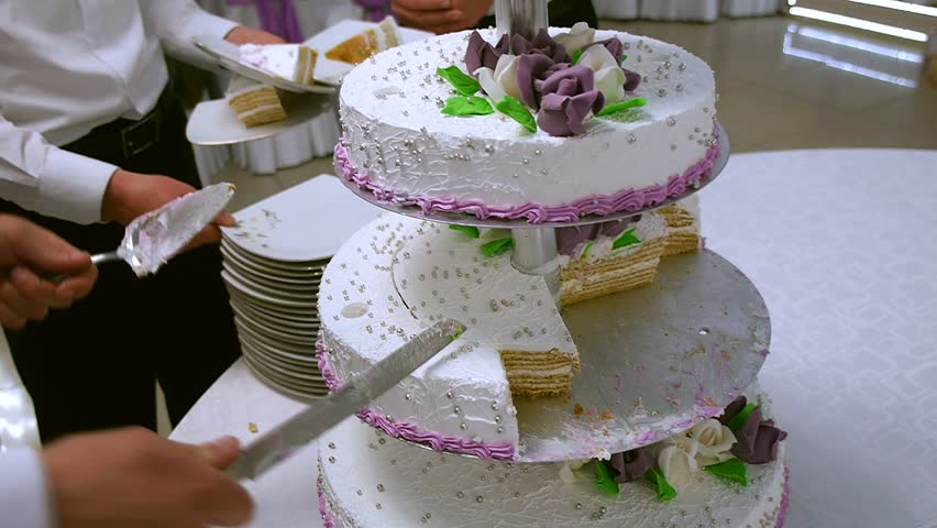 Three Tear Wedding Cakes.Three Tiered Wedding Cake Is Cut Stock Footage Video 100 Royalty Free 10139882 Shutterstock