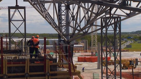 Metal beams are used as the basis in the frame of the new building of Pulkovo Airport. View on the airport from the construction site