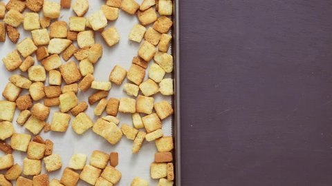 Fresh french toast croutons in black bowl.