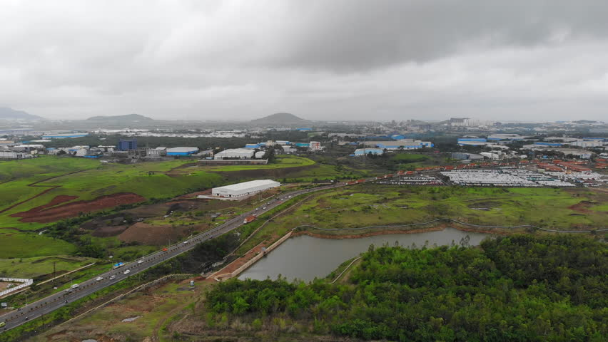 Aerial panoramic view of industrial zone in city of Pune, modern factories and warehouses - Maharashtra, landscape panorama of India, Asia from above