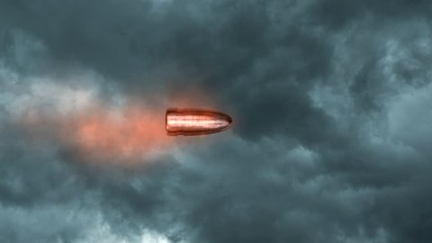 Bullet flying on background of dark cloud sky. Slow Motion of bullet on foreground.