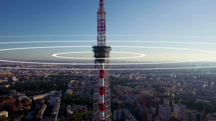 Visualization of radio waves coming from a large TV antenna towering above the city. Concept visualization of a phone mast emitting radio signals in concentric circles. | Shutterstock HD Video #1014044732