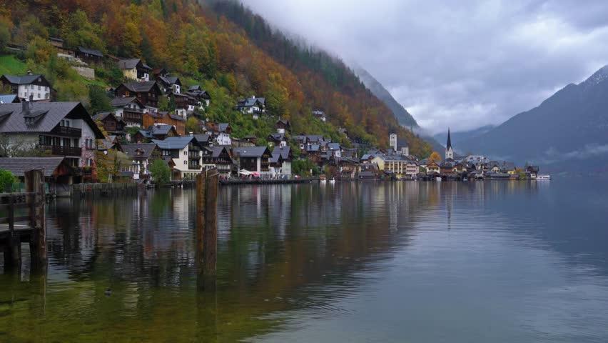 Traditional homes near lake in famous Hallstatt village in Salzkammergut area, Austria   Shutterstock HD Video #1014065942