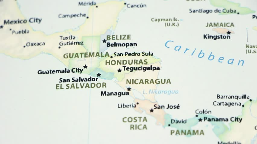 Guatemala, Honduras, and Nicaragua on a political map of the world. Video defocuses showing and hiding the map.