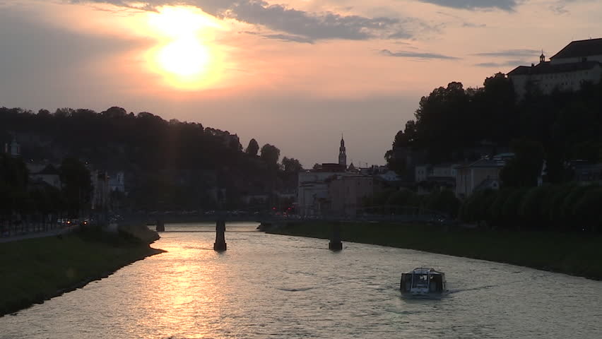 Sunset in Salzburg, River Boat Mozart, View from the karolingen bridge