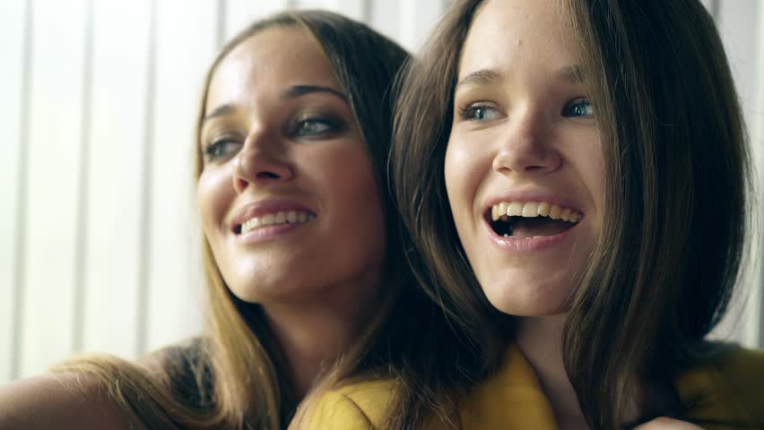 CU, Portrait: Two young attractive girl doing selfies, use smartphone. Smiling.  #1014079112