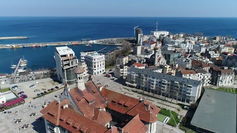 Aerial footage of the old district of a city by the sea.