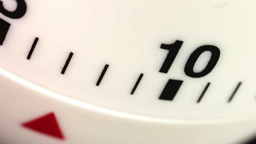 White kitchen egg timer countdown to zero time lapse. | Shutterstock HD Video #1014192782