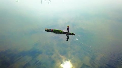 A fisherman rowing a boat at Loktak lake, Manipur, India