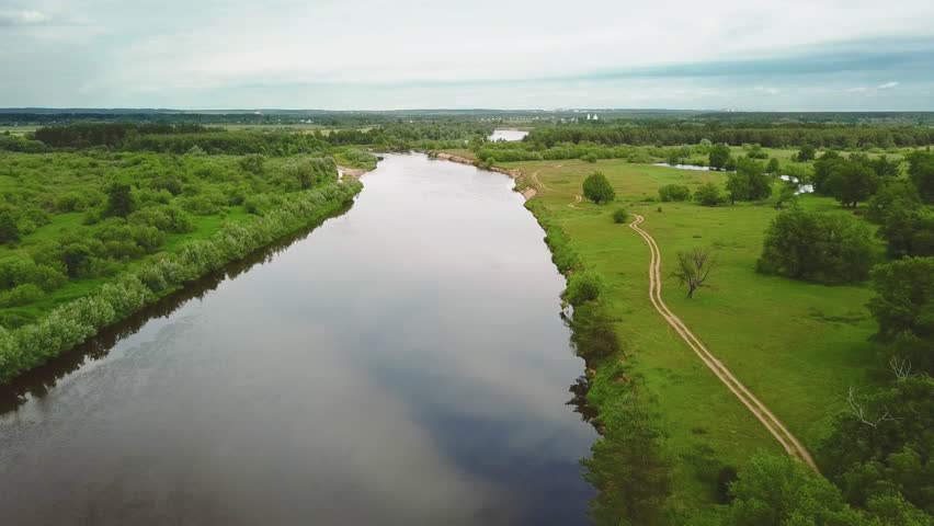 Flying over the river on a cloudy summer day