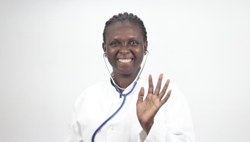young woman doctor standing with stethoscope smiling to make a thumb sign.