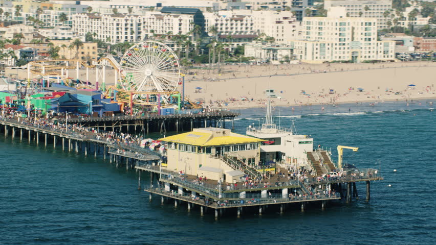Aerial view of the Santa Monica Pier in Los Angeles, California during the day. Shot with a RED camera. 4k footage.