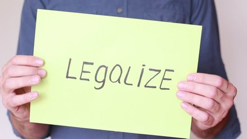 """""""Legalize"""" inscrition in male hands"""