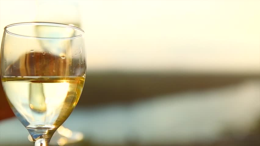 People holding Glass of Wine, Making a toast over Sunset sky. Birthday. Friends drinking White Wine, toasting. Clink. Party outdoors. Enjoying time together. Slow motion 240 fps 4K UHD video | Shutterstock HD Video #1014269582
