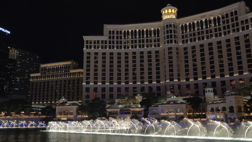 Las Vegas, Nevada - April 2018: Bellagio water fountain show in Las Vegas with original ambient sound. Fountains of Bellagio. 4k video with panoramic shooting and ambient sound.