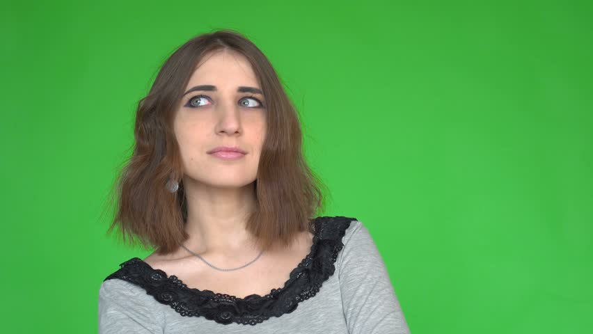 Young woman looking annoyed and waiting over green background. Posing against a removable chroma key background. Concept of emotions. | Shutterstock HD Video #1014302282