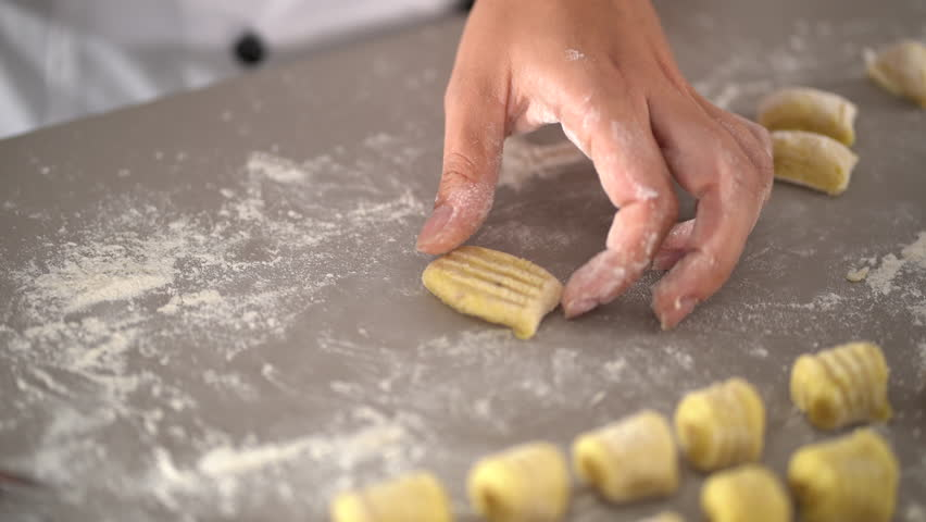 4K cooking footage, close up preparing cooking fresh gnocchi in kitchen