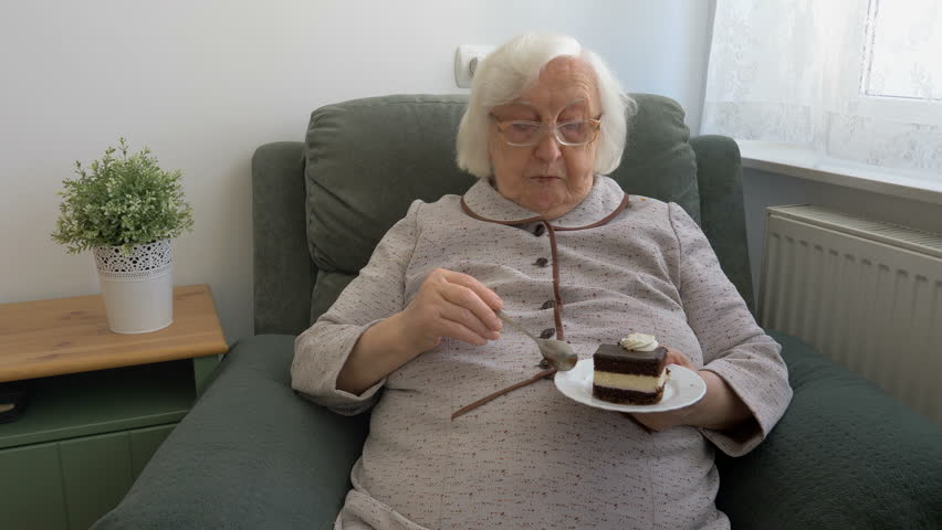 Old lady is eating cake