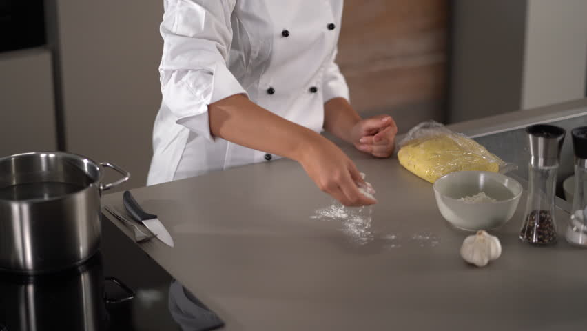 4K cooking footage, woman working with chilled dough in kitchen preparing for cooking gnocchi