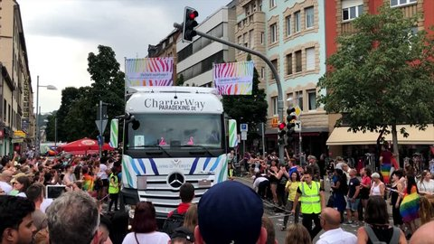 Stuttgart, Germany - July 28, 2018: Participants are celebrating Christopher Street Day, the gay lesbian pride festival in Stuttgart, Germany on the truck of the ENBW energy company, also located in