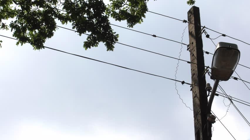 Telephone pole. Blue sky. Street lamp. 4K, UHD, 50p,Panning,Closeup,