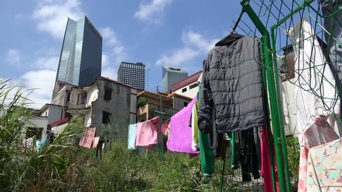 Laundry is drying on a rope in Xian Urban Village slums of Guangzhou. Guangdong, China