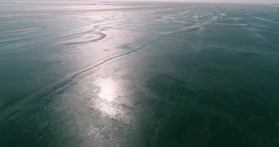 Aerial view of Dutch frozen sea | Shutterstock HD Video #1014425672