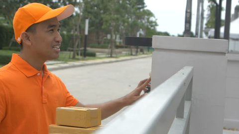 Delivery man ring a bell to call customers for receive a parcel at front home
