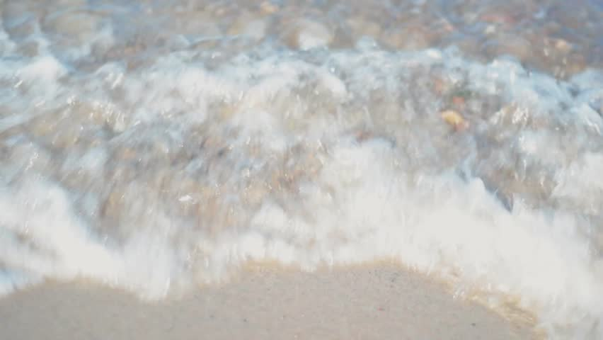 Close up of sea waves on a sunny summer evening | Shutterstock HD Video #1014475802