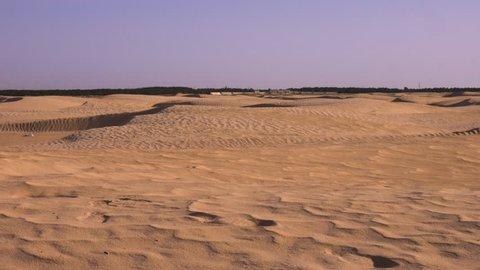 Desert landscape with sand dunes, handheld shot. Sahara, Tunisia North Africa