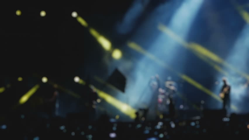 Rock band is on a stage during musical festival, blurred in slow motion | Shutterstock HD Video #1014562652