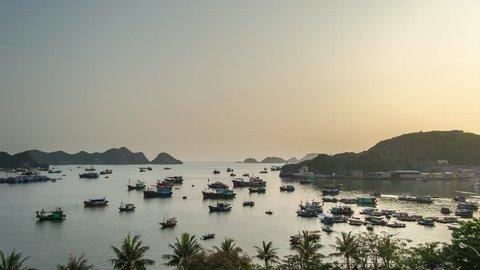 Timelapse of boats during the sunset hours around harbor of Cat Ba island, Vietnam.