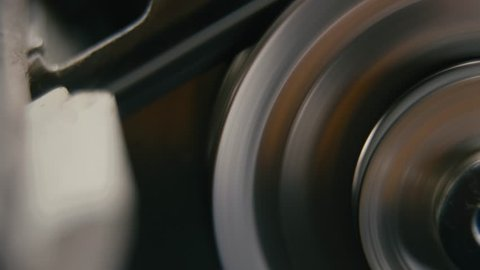 Close-up View Of Movement Of Metal Wheel In A Mechanical Device. Gearbox