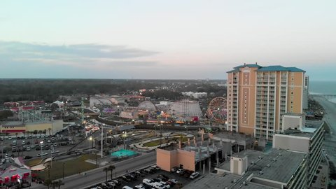 Myrtle Beach, South Carolina. Aerial view of city beach and luna park at sunset.