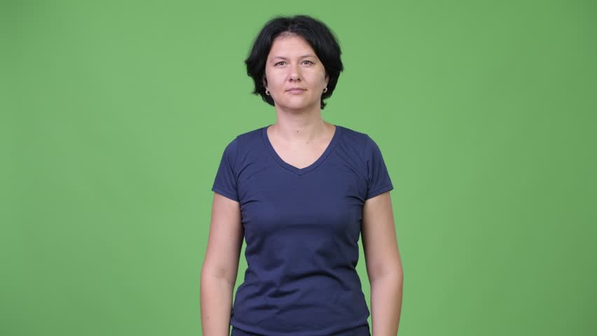 Stressed woman covering ears from loud noise   Shutterstock HD Video #1014685112