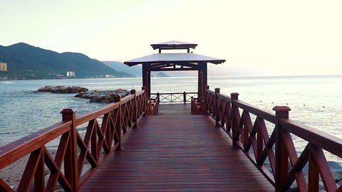 Wooden pier from The Pacific Ocean in Puerto Vallarta, located between Jalisco and Nayarit states, Mexico.
