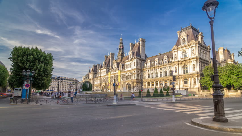 Hotel de Ville or Paris city hall timelapse hyperlapse in sunny day. Traffic on the road. This building has been used as the location of the municipality of Paris since 1357