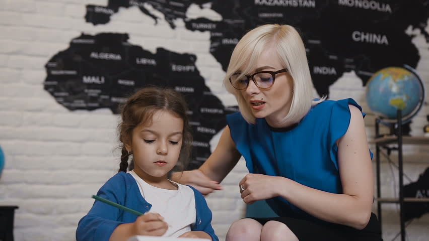 Mom Teaches Her Daughter to Stock Footage Video (100% Royalty-free)  1014720152 | Shutterstock