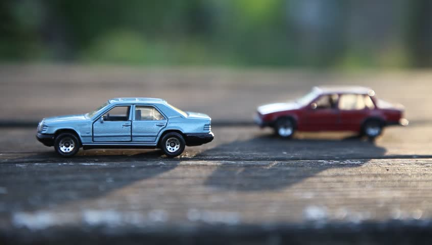 Toy cars models on table in summer garden. Retro, vintage.