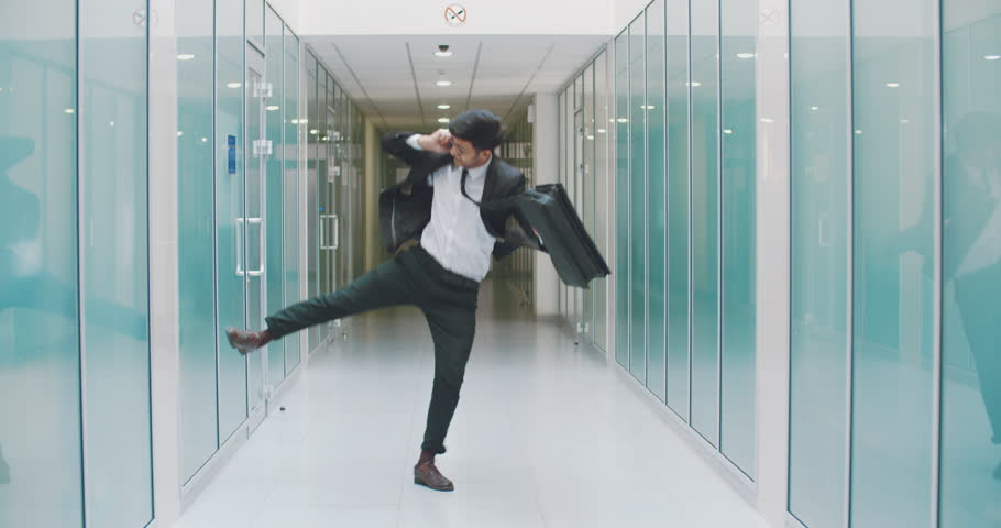 Young south asian businessman doing victory dance after promotion. busineessman happy after successful deal. business, victory concept 4k | Shutterstock HD Video #1014792542
