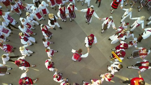 TULCEA, ROMANIA - AUGUST 08: Friendship dance (aerial view) at the International Folklore Festival for Children and Youth - Golden Fish on August 08, 2018 in Tulcea, Romania.
