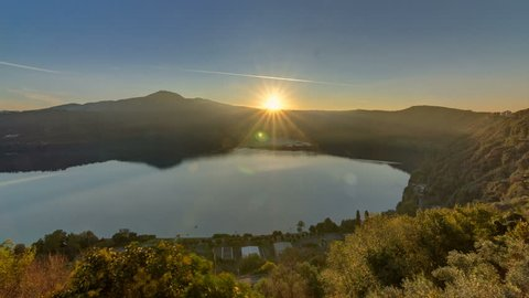 Panoramic view of Albano Lake coast at sunrise timelapse, Rome Province, Latium, central Italy. Green trees at morning light