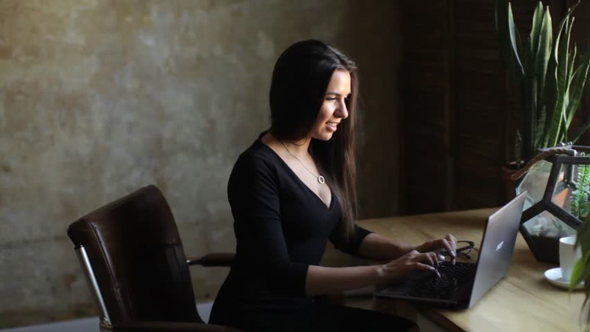 Stylish happy woman uses laptop in home office | Shutterstock HD Video #1014822302
