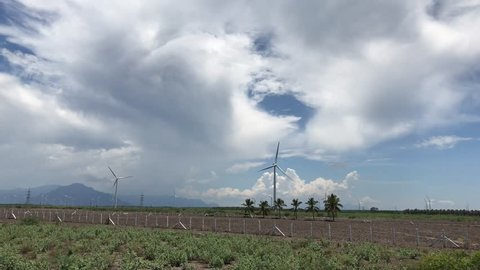 Wind mills or wind farm, group of individual wind turbines cover an extended area of Pollachi, Tamil Nadu India. converts the wind energy to produce electricity or generate power.