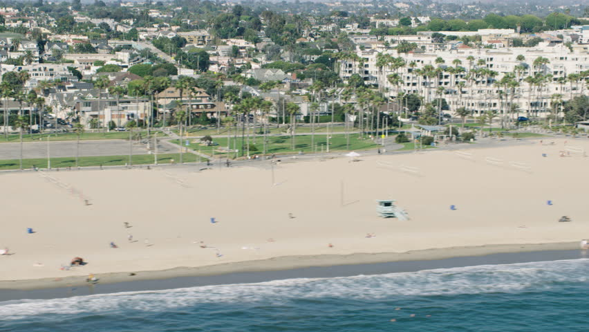 Aerial view of the California beach during the day. Shot of the shoreline of Los Angeles. Shot with a RED camera. 4k footage.