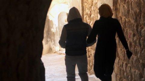 walking women and men A street of Mardin in Turkey