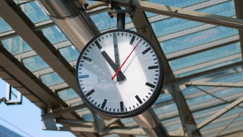 Public clock on the train station in 4k slow motion 60fps