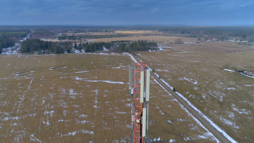 Landscape aerial view of the big field in the area with the GSM 4G 5G glas micro fibre communications tower on the center   Shutterstock HD Video #1014914572