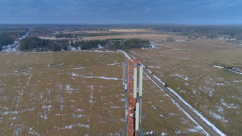 Landscape aerial view of the big field in the area with the GSM 4G 5G glas micro fibre communications tower on the center